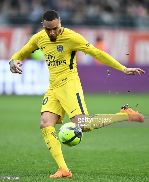 Paris SaintGermain's French defender Layvin Kurzawa plays the ball during the French L1 football match between Troyes and Paris SaintGermain at the...