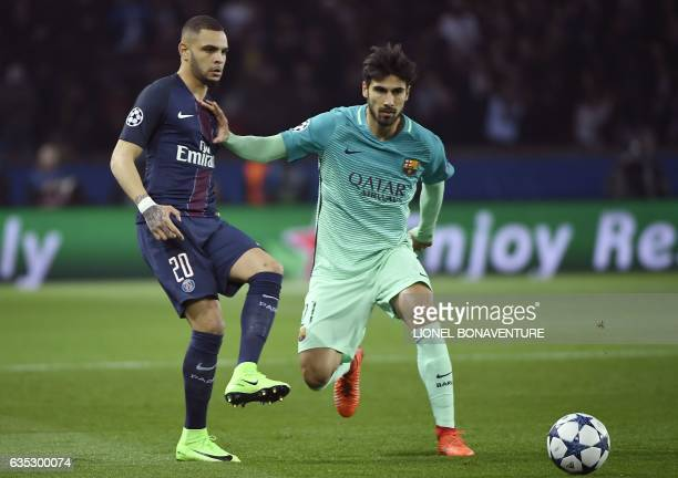 Paris SaintGermain's French defender Layvin Kurzawa vies with Barcelona's Portuguese midfielder Andre Gomes during the UEFA Champions League round of...