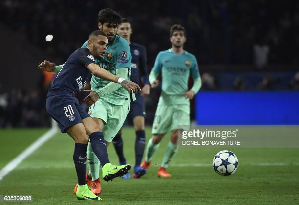 Paris Saint-Germain's French defender Layvin Kurzawa vies with Barcelona's Portuguese midfielder Andre Gomes during the UEFA Champions League round...