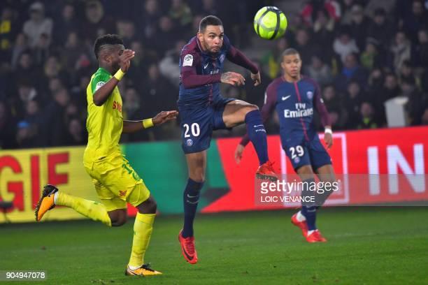 Paris SaintGermain's French defender Layvin Kurzawa vies with Nantes' Nigerian defender Chidozie Awaziem during the French L1 football match between...