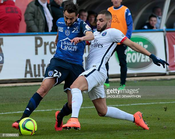 Paris SaintGermain's French defender Layvin Kurzawa vies with Troyes' FrancoTunisian midfielder Fabien Camus during the French Ligue 1 football match...