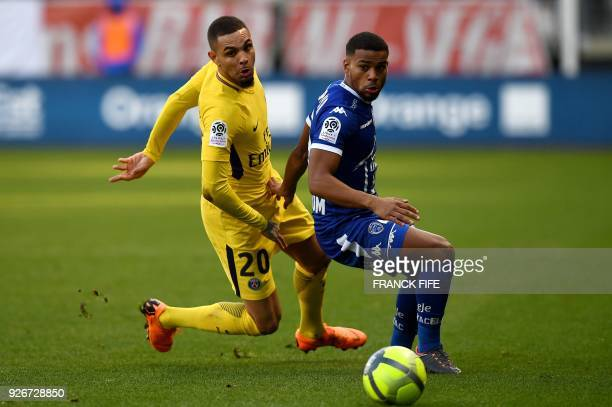 Paris SaintGermain's French defender Layvin Kurzawa vies with Troyes' French forward Samuel Grandsir during the French L1 football match between...