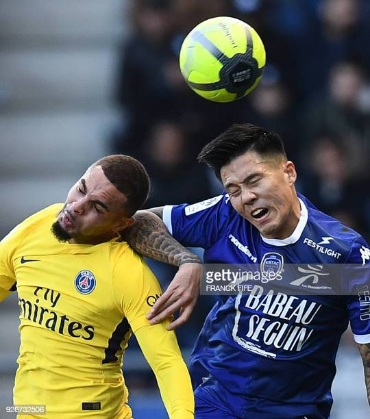 Paris SaintGermain's French defender Layvin Kurzawa vies with Troyes' French forward Hyunjun Suk during the French L1 football match between Troyes...