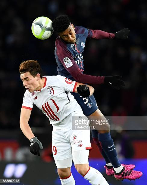 Paris SaintGermain's French defender Presnel Kimpembe and Lille's Argentinian forward Ezequiel Ponce go for a header during the French L1 football...