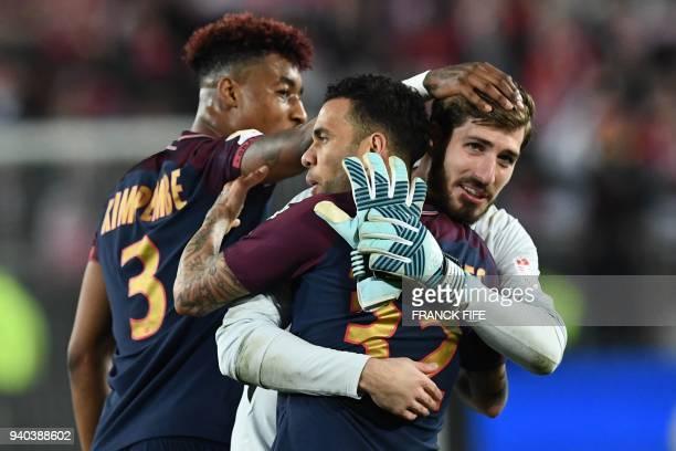Paris SaintGermain's French defender Presnel Kimpembe Brazilian defender Daniel Alves and German goalkeeper Kevin Trapp celebrate after victory in...