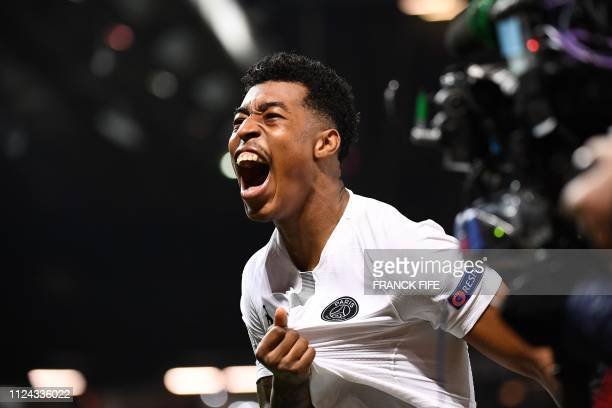 TOPSHOT Paris SaintGermain's French defender Presnel Kimpembe celebrates scoring the opening goal during the first leg of the UEFA Champions League...