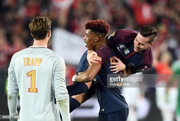 Paris SaintGermain's French defender Presnel Kimpembe German goalkeeper Kevin Trapp and German midfielder Julian Draxler celebrate after victory in...