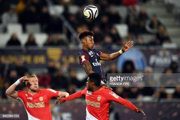 Paris SaintGermain's French defender Presnel Kimpembe heads the ball ahead of Monaco's French midfielder Thomas Lemar and Monaco's Polish defender...