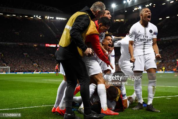 Paris SaintGermain's French defender Presnel Kimpembe is congratuled by teammates after scoring a goal during the first leg of the UEFA Champions...