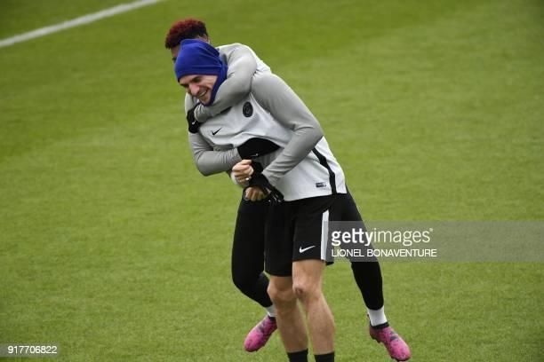 Paris SaintGermain's French defender Presnel Kimpembe jokes with Paris SaintGermain's Belgian defender Thomas Meunier during a training session at in...