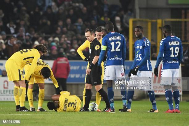 Paris SaintGermain's French defender Presnel Kimpembe lies on the pitch during the French L1 football match between Strasbourg and Paris SaintGermain...