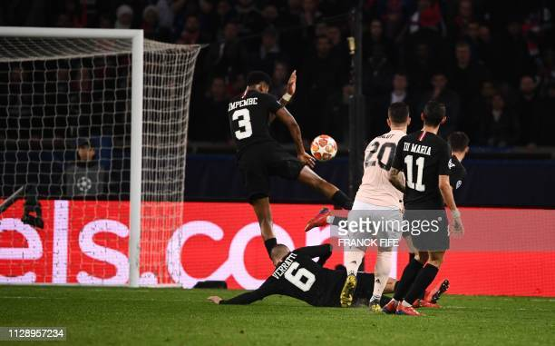 Paris SaintGermain's French defender Presnel Kimpembe makes a hand fault leading the referee to show after videoassist the penalty spot during the...