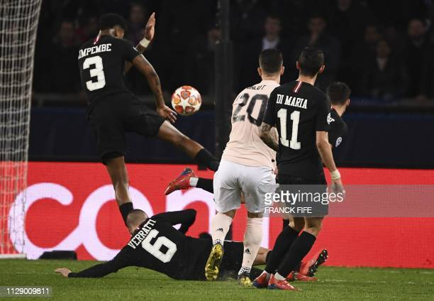 TOPSHOT Paris SaintGermain's French defender Presnel Kimpembe makes a hand fault leading the referee to show after videoassist the penalty spot...