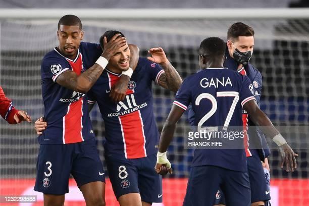 Paris Saint-Germain's French defender Presnel Kimpembe, Paris Saint-Germain's Argentinian midfielder Leandro Paredes, Paris Saint-Germain's...