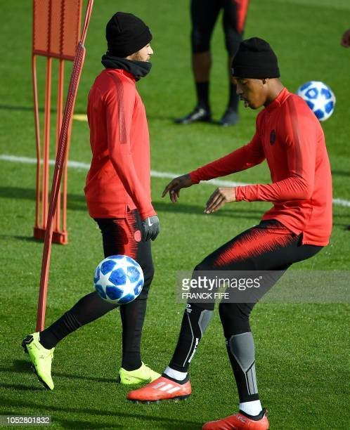 Paris SaintGermain's French defender Presnel Kimpembe plays the ball during a training session of the Paris SaintGermain football team on October 23...