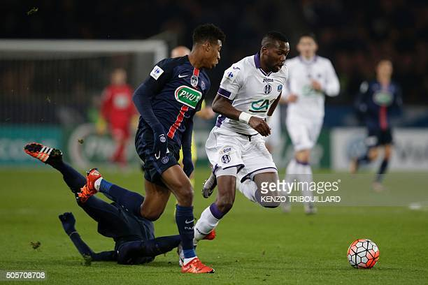 Paris SaintGermain's French defender Presnel Kimpembe vies with Toulouse's Malian midfielder Tongo Doumbia during the French Cup football match Paris...