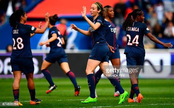 Paris SaintGermain's French defender Sabrina Delannoy and Paris SaintGermain's midfielder Shirley Cruz react after scoring a second goal during the...