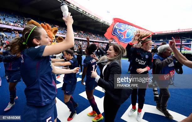 Paris SaintGermain's French defender Sabrina Delannoy and Paris SaintGermain's French defender Laure Boulleau celebrate their victory at the end of...