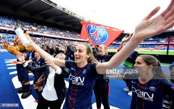 Paris SaintGermain's French defender Sabrina Delannoy and teammates celebrate their victory at the end of the UEFA Women's Champions League semifinal...