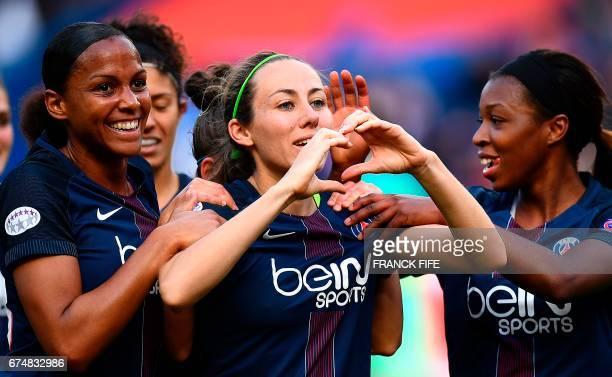 Paris SaintGermain's French defender Sabrina Delannoy celebrates scoring the opening goal with Paris SaintGermain's forward MarieLaure Delie during...