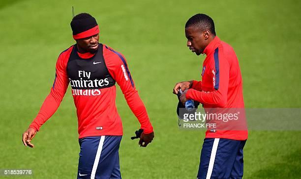 Paris Saint-Germain's French defender Serge Aurier and Paris Saint-Germain's French midfielder Blaise Matuidi arrive for a training session on April...