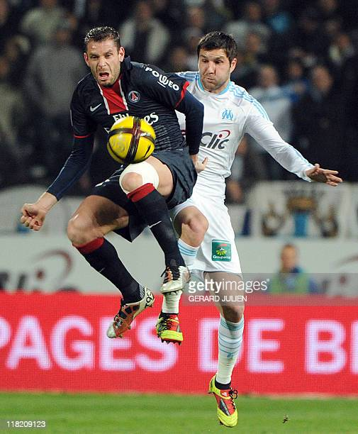Paris SaintGermain's French defender Sylvain Armand vies with Olympique Marseille's forward AndréPierre Gignac during their French L1 football match...