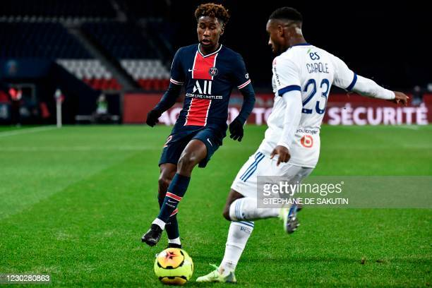 PAris Saint-Germain's French defender Timothee Pembele fights for the ball with Strasbourg's French defender Lionel Carole during the French L1...