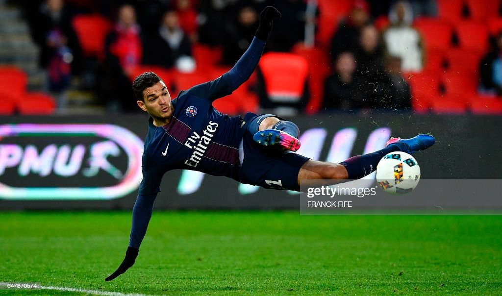 TOPSHOT - Paris Saint-Germain's French forward Hatem Ben Arfa kicks the ball during the French L1 football match between Paris Saint-Germain and Nancy at the Parc des Princes stadium in Paris on March 4, 2017. Paris Saint-Germain won 1-0. /