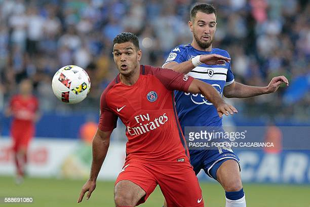 Paris SaintGermain's French forward Hatem Ben Arfa vies with Bastia's French defender Mathieu Peybernes during the French Ligue 1 football match...