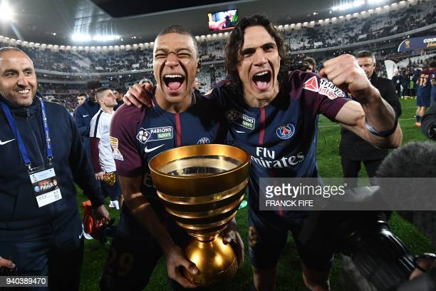 Paris SaintGermain's French forward Kylian Mbappé and teammate Uruguayan forward Edinson Cavani celebrate after victory in the French League Cup...