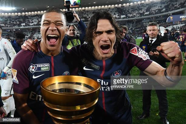 TOPSHOT Paris SaintGermain's French forward Kylian Mbappé and teammate Uruguayan forward Edinson Cavani celebrate after victory in the French League...