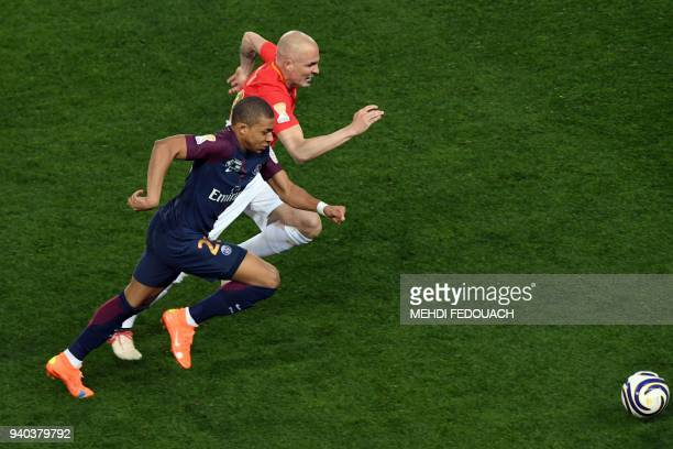 Paris SaintGermain's French forward Kylian Mbappé fights for the ball with Monaco's Italian defender Andrea Raggi during the French League Cup final...