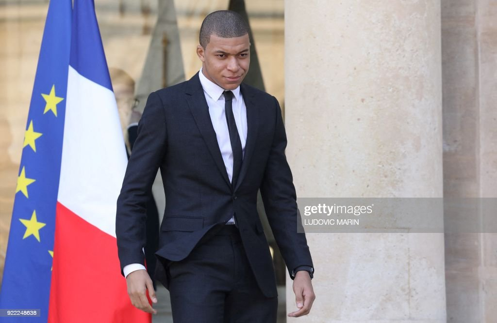 Paris Saint-Germain's French forward Kylian Mbappé leaves the Elysee presidential palace after a lunch with the French and Liberian President on February 21, 2018 in Paris. /