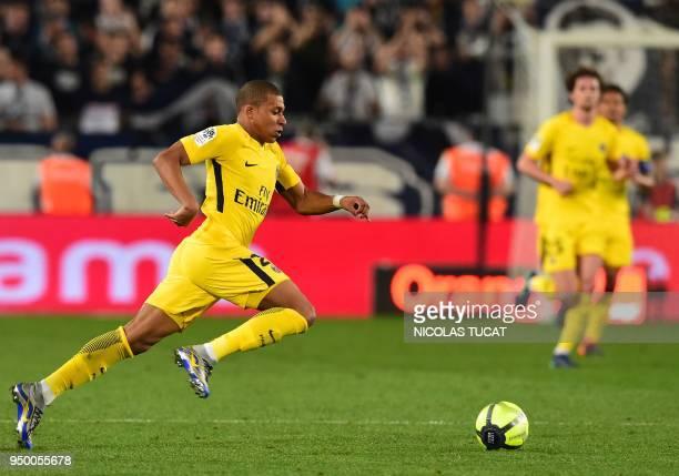 Paris SaintGermain's French forward Kylian Mbappé runs with the ball during the French Ligue 1 football match between Bordeaux and Paris SaintGermain...
