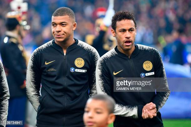 Paris SaintGermain's French forward Kylian Mbappe and Brazilian forward Neymar react as stand prior to the start of the French Cup final football...