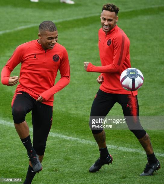 Paris SaintGermain's French forward Kylian Mbappe and Paris SaintGermain's Brazilian forward Neymar take part in a training session at...