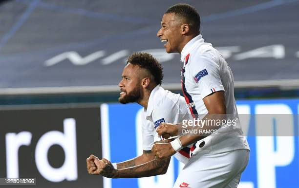 TOPSHOT Paris SaintGermain's French forward Kylian Mbappe and Paris SaintGermain's Brazilian forward Neymar celebrate after Paris SaintGermain's...