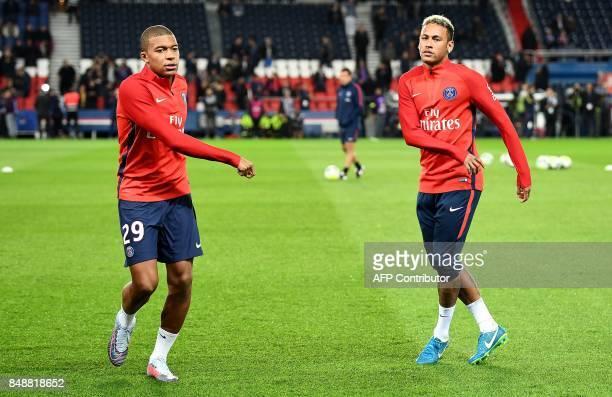 Paris SaintGermain's French forward Kylian Mbappe and Paris SaintGermain's Brazilian forward Neymar warm up ahead of the French Ligue 1 football...