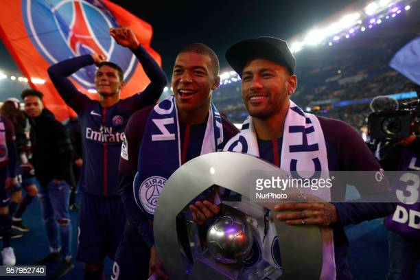 Paris SaintGermain's French forward Kylian MBappe and Paris SaintGermain's Brazilian forward Neymar pose with a trophy after winning the French L1...