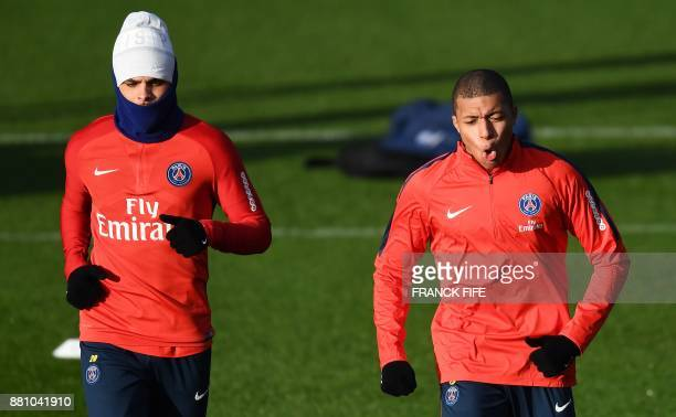 Paris SaintGermain's French forward Kylian MBappe and Paris SaintGermain's French defender Layvin Kurzawa attend a training session in...