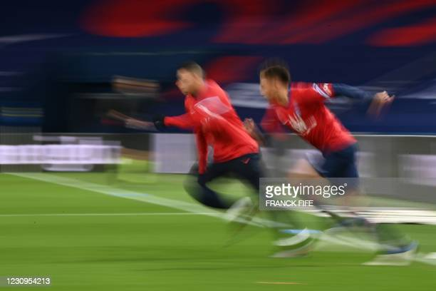 Paris Saint-Germain's French forward Kylian Mbappe and Paris Saint-Germain's German defender Thilo Kehrer warm up prior to the French L1 football...