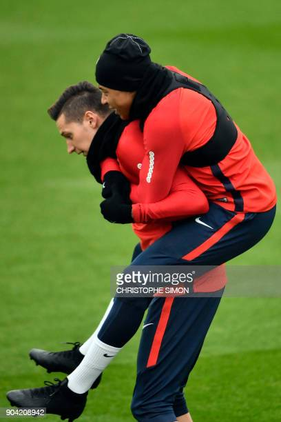 Paris SaintGermain's French forward Kylian Mbappe and Paris SaintGermain's German midfielder Julian Draxler take part in a training session on...
