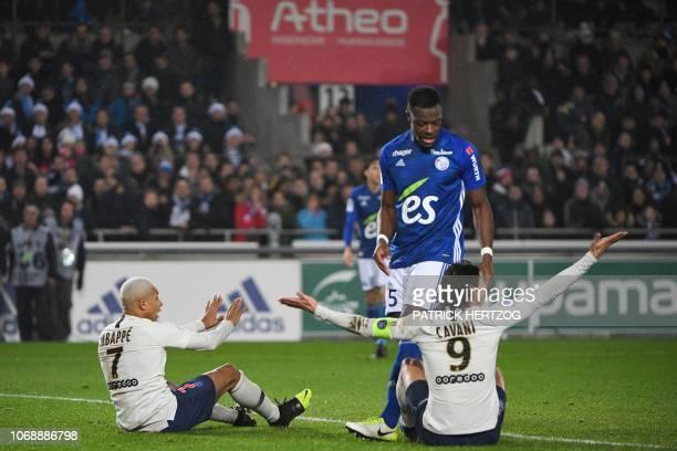 Paris SaintGermain's French forward Kylian Mbappe and Paris SaintGermain's Uruguayan forward Edinson Cavani react as they sir on the football pitch...