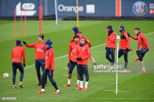 Paris SaintGermain's French forward Kylian Mbappe and teammates attend a training session of French L1 football club Paris SaintGermain in...