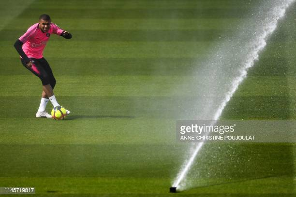 TOPSHOT Paris SaintGermain's French forward Kylian Mbappe attends a training session at the club's Camp des Loges training grounds in...