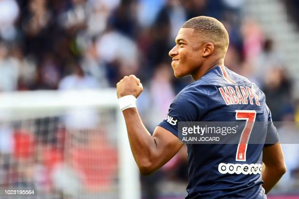 Paris SaintGermain's French forward Kylian Mbappe celebrates after scoring a goal during the French L1 football match Paris SaintGermain vs Angers on...