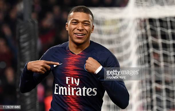 Paris SaintGermain's French forward Kylian MBappe celebrates after scoring a goal during the French L1 football match between Paris SaintGermain and...