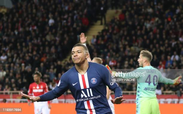 Paris Saint-Germain's French forward Kylian Mbappe celebrates after scoring a goal during the French L1 football match between Monaco and Paris...