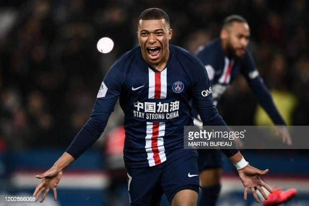 TOPSHOT Paris SaintGermain's French forward Kylian Mbappe celebrates after scoring a goal during the French L1 football match between Paris...