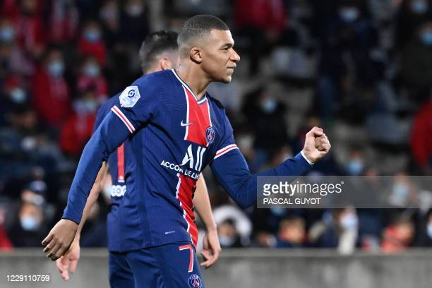 Paris Saint-Germain's French forward Kylian Mbappe celebrates after scoring a goal during the French L1 football match between Nimes and Paris Saint...